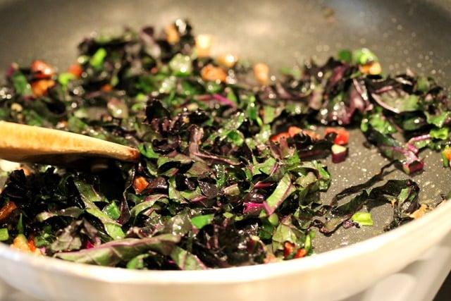 Stir kale bacon onion in skillet