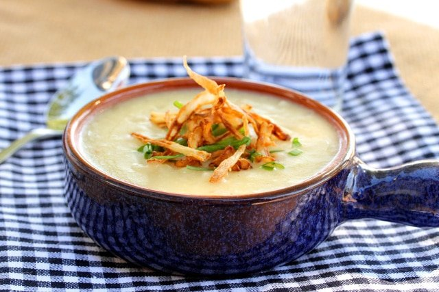 Roasted Garlic Potato Soup with Crispy Onions in bowl