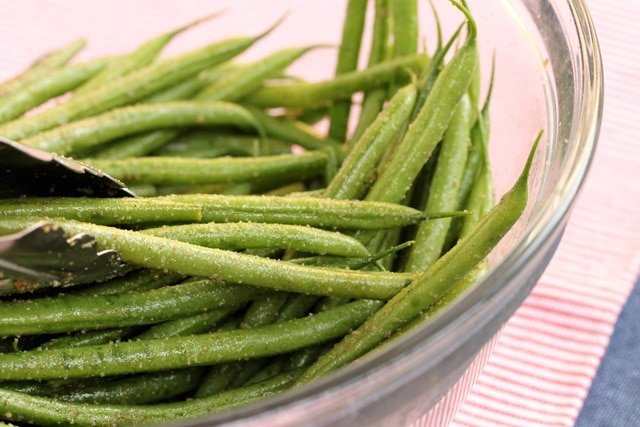 Mix green beans in bowl