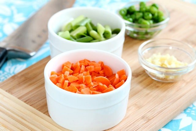 Chopped carrots and onions in bowls