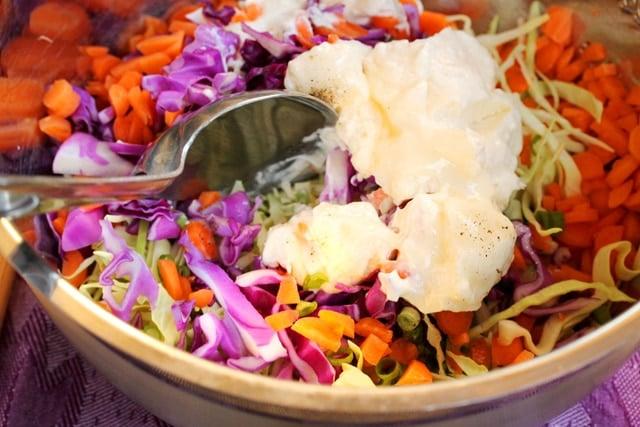 Stir coleslaw in bowl