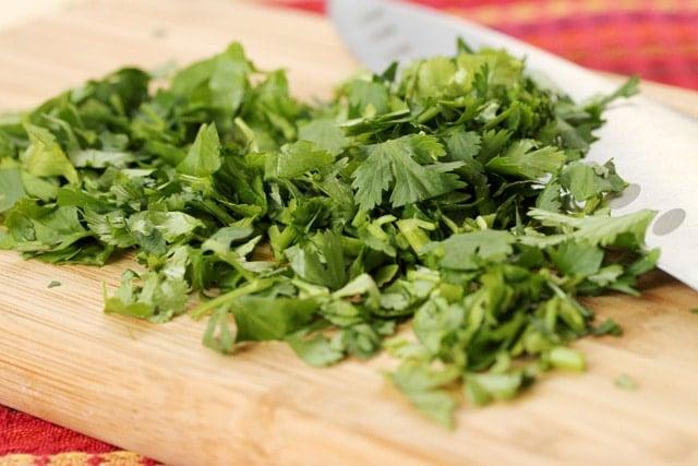 Chopped cilantro on cutting board