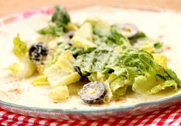 Caesar salad on tortilla wrap on plate
