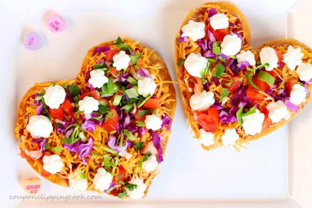 Heart shaped bean tostadas on plate