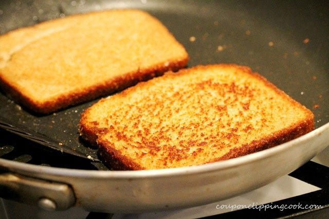 Toast slices of bread in skillet