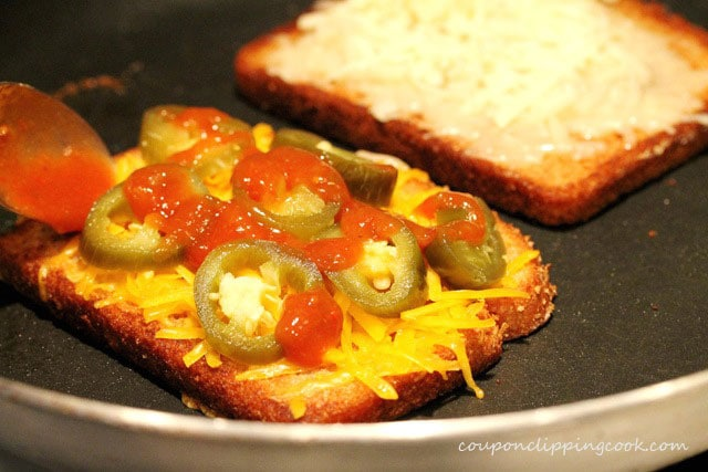 Salsa on grilled cheese in pan