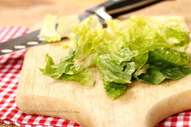 Cut Romaine lettuce on cutting board