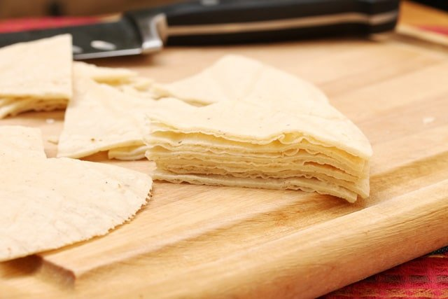 Cut corn tortillas on cutting board
