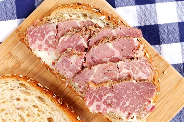 Slices of corned beef on bread