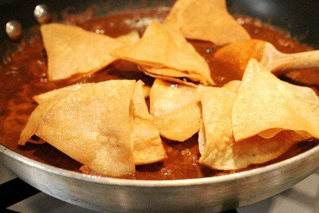 Add chips to chili in skillet