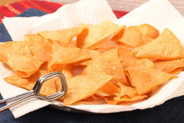 Tortilla chips sitting on plate with paper towel