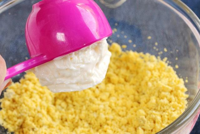 Add mayonnaise to bowl