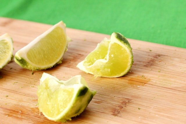 Squeezed limes on cutting board