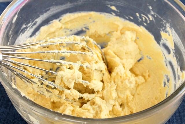 Whisk hard boiled egg yolks in bowl