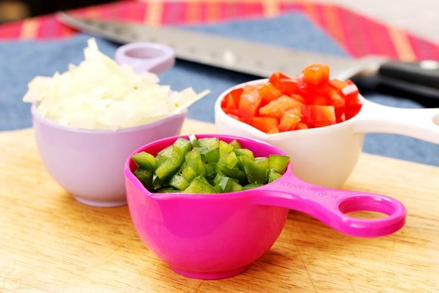 Chopped vegetables in measuring cups