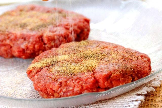 Add salt on hamburger on plate