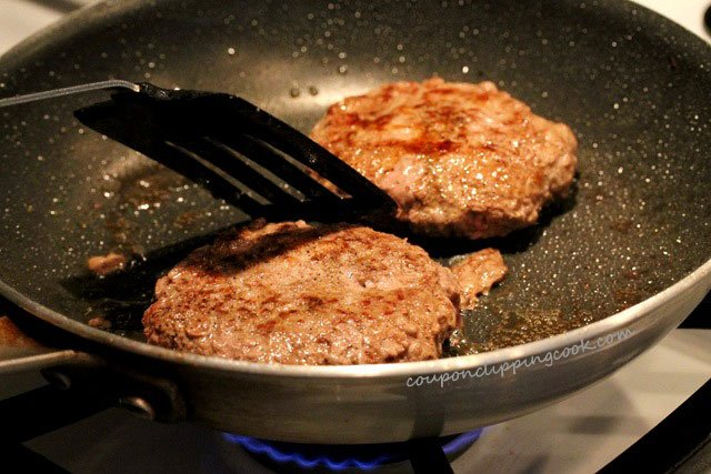 Cook hamburger patties in skillet