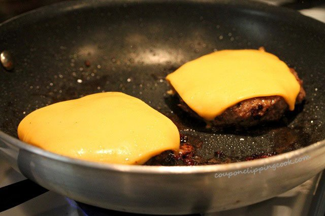 Melt cheese on hamburger in skillet