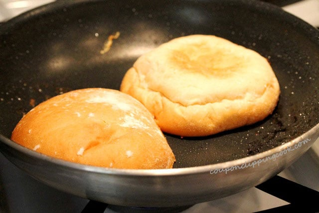 Toast hamburger buns in skillet