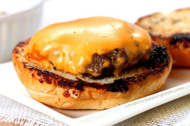 Cheeseburger patty on bun on plate
