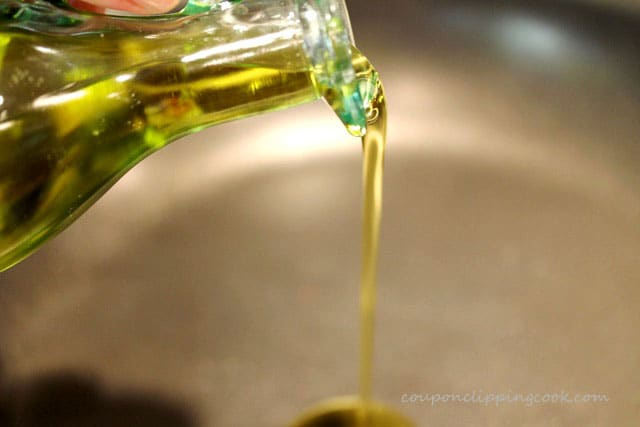 Pour olive oil in skillet