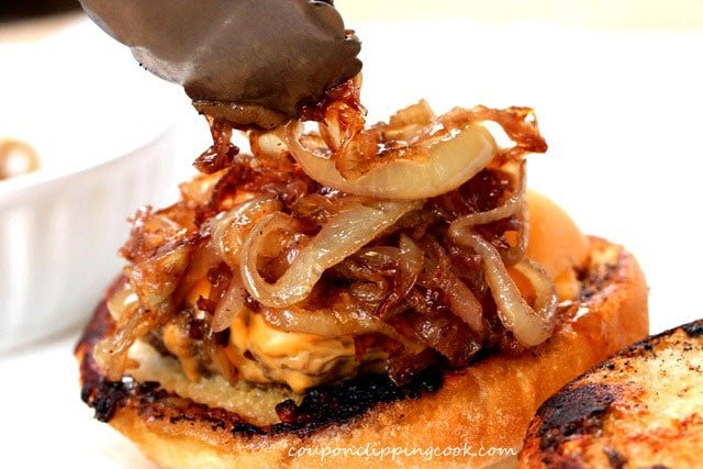 Add caramelized onions on cheeseburger