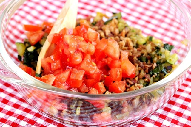 Chopped tomatoes and vegetables in bowl