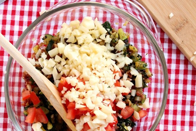 Diced cheese and vegetables in bowl
