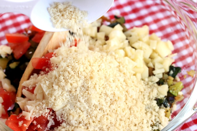 Add bread crumbs to vegetables in bowl