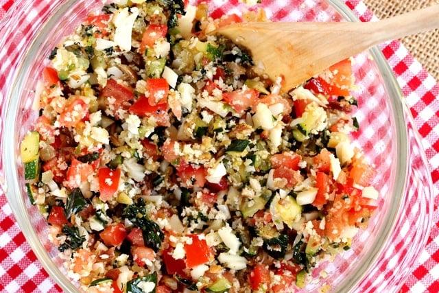 Stir vegetables in bowl