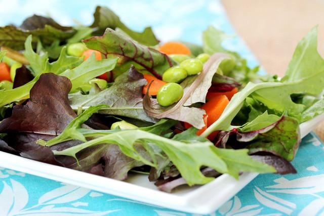 Edamame in salad on plate