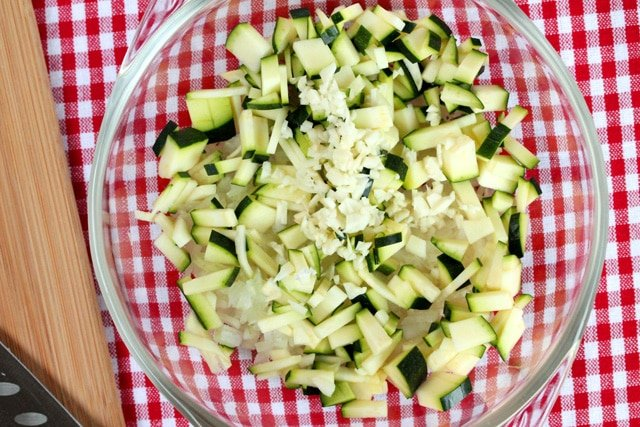 Diced garlic in bowl with zucchini