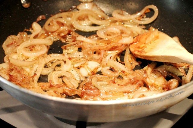 Saute wine and onions in skillet