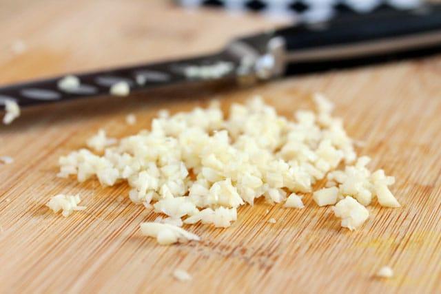 Diced garlic on cutting board