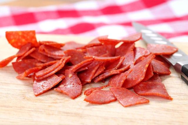 Cut pepperoni on cutting board