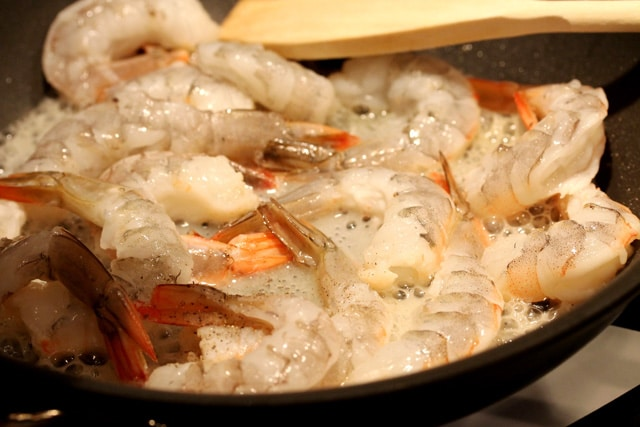 Cook shrimp in skillet
