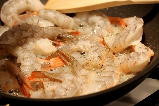Pepper on shrimp in skillet
