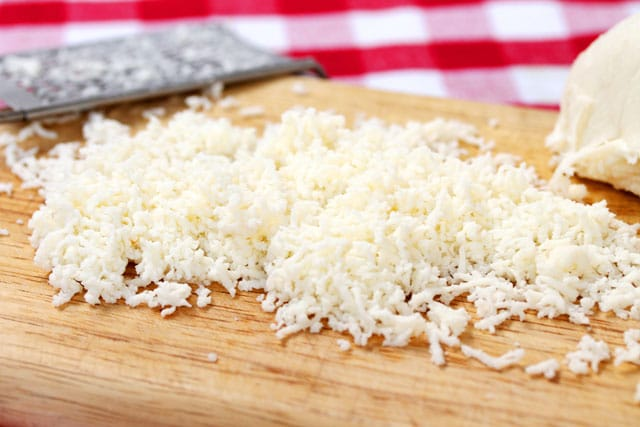 Shredded mozzarella cheese on board