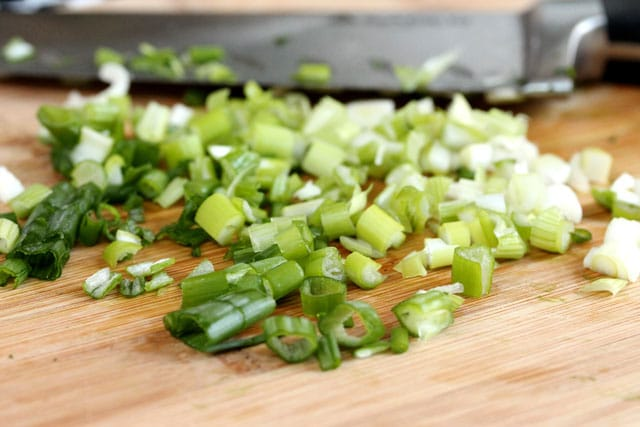 Chopped green onions on cutting board