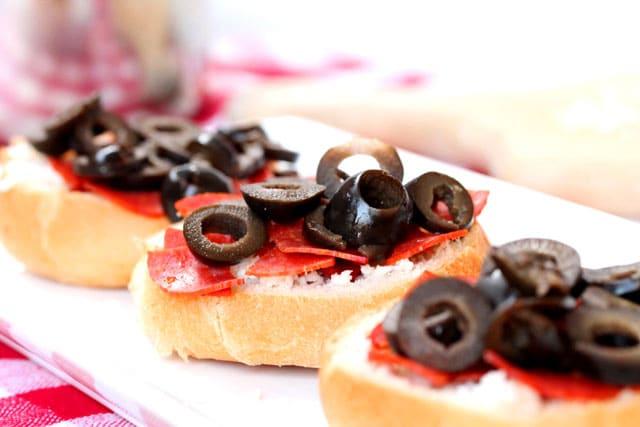 Black olives pepperoni on pizza rolls