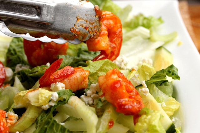 Add sriracha shrimp on salad