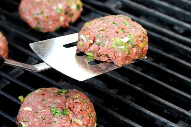 Cilantro burger patties on grill
