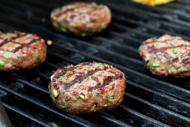 Grill hamburger patties on BBQ