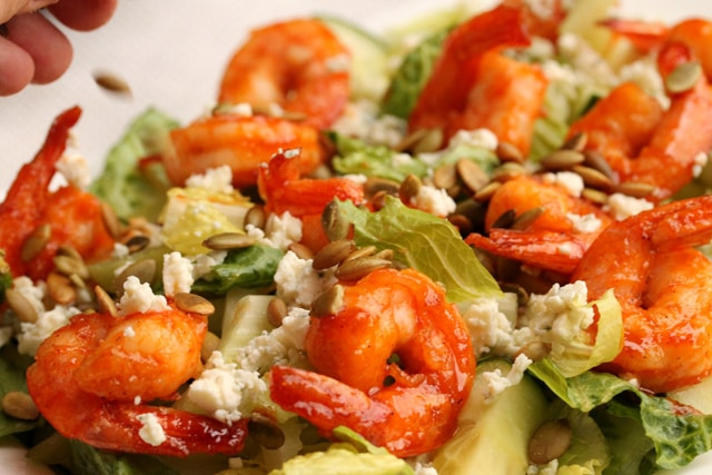 Add pepita seeds on sriracha shrimp salad