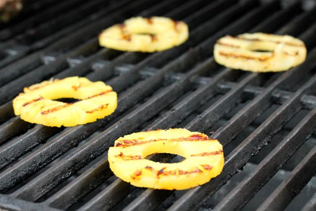 Grill pineapple slices on BBQ