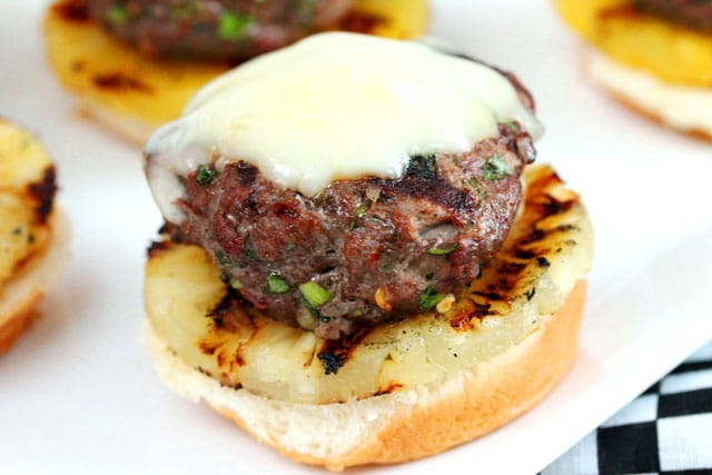 Hamburger patty with cheese on roll