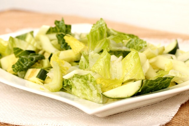 Lettuce and cucumbers on plate