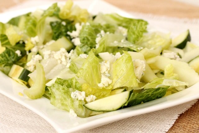 Crumbled blue cheese on salad