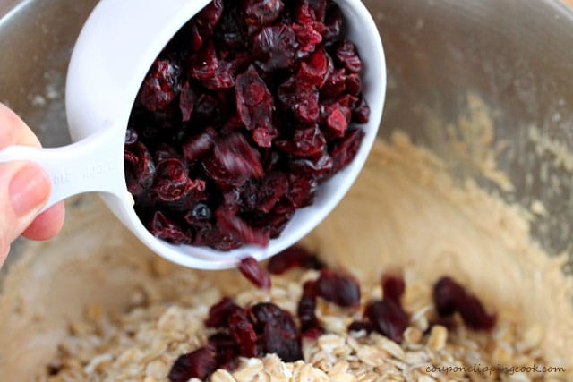 Add dried cranberries to bowl