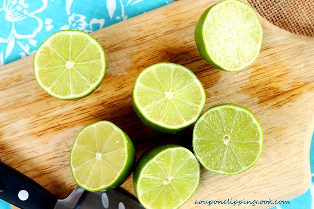 Halved limes on cutting board